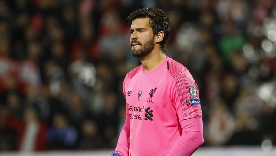 BELGRADE, SERBIA - NOVEMBER 06: Alisson Becker of Liverpool reacts during the Group C match of the UEFA Champions League between Red Star Belgrade and Liverpool at Rajko Mitic Stadium on November 06, 2018 in Belgrade, Serbia. (Photo by Srdjan Stevanovic/Getty Images)