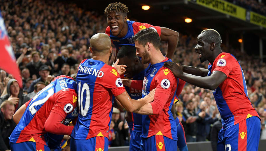 LONDON, ENGLAND - APRIL 10:  Yohan Cabaye of Crystal Palace (obscured) is mobbed by team mates as he celebrates scoring their second goal during the Premier League match between Crystal Palace and Arsenal at Selhurst Park on April 10, 2017 in London, England.  (Photo by Mike Hewitt/Getty Images)