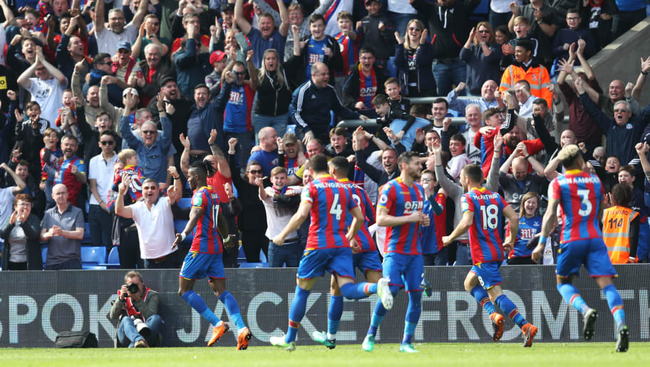 LONDON, ENGLAND - APRIL 14:  Wilfried Zaha of Crystal Palace celebrates with teammates after scoring his sides first goal during the Premier League match between Crystal Palace and Brighton and Hove Albion at Selhurst Park on April 14, 2018 in London, England.  (Photo by Christopher Lee/Getty Images)
