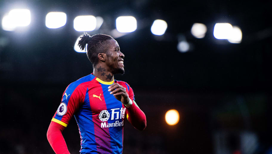 LONDON, ENGLAND - DECEMBER 01: Wilfried Zaha of Crystal Palace looks on during the Premier League match between Crystal Palace and Burnley FC at Selhurst Park on December 1, 2018 in London, United Kingdom. (Photo by Sebastian Frej/MB Media/Getty Images)
