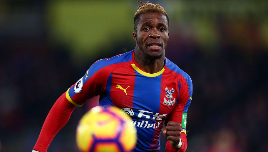 LONDON, ENGLAND - DECEMBER 26:  Wilfred Zaha of Crystal Palace tracks down the ball during the Premier League match between Crystal Palace and Cardiff City at Selhurst Park on December 26, 2018 in London, United Kingdom.  (Photo by Jordan Mansfield/Getty Images)