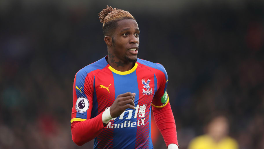 LONDON, ENGLAND - DECEMBER 30: Wilfried Zaha of Crystal Palace during the Premier League match between Crystal Palace and Chelsea FC at Selhurst Park on December 30, 2018 in London, United Kingdom. (Photo by James Williamson - AMA/Getty Images)