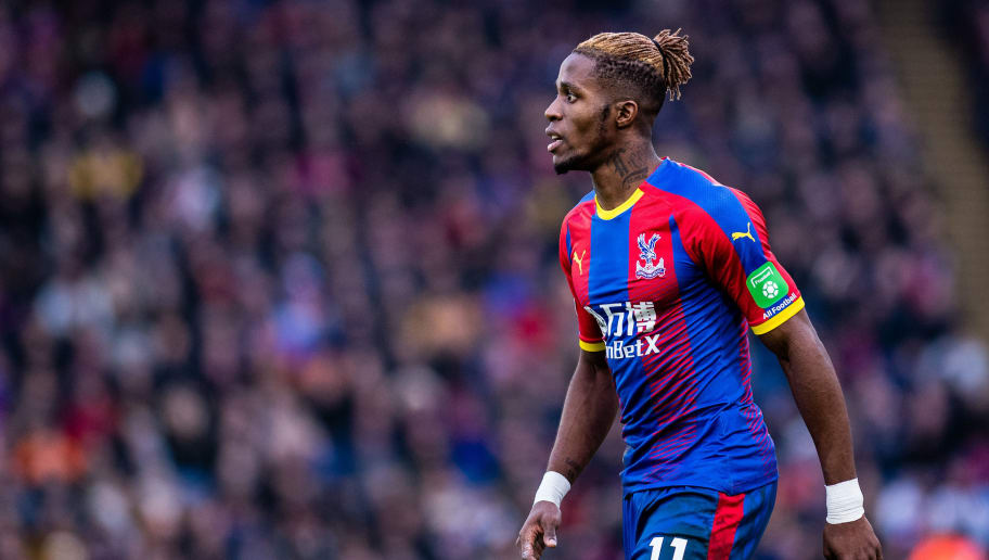 LONDON, ENGLAND - DECEMBER 30: Wilfried Zaha of Crystal Palace looks on during the Premier League match between Crystal Palace and Chelsea FC at Selhurst Park on December 30, 2018 in London, United Kingdom. (Photo by MB Media/Getty Images)