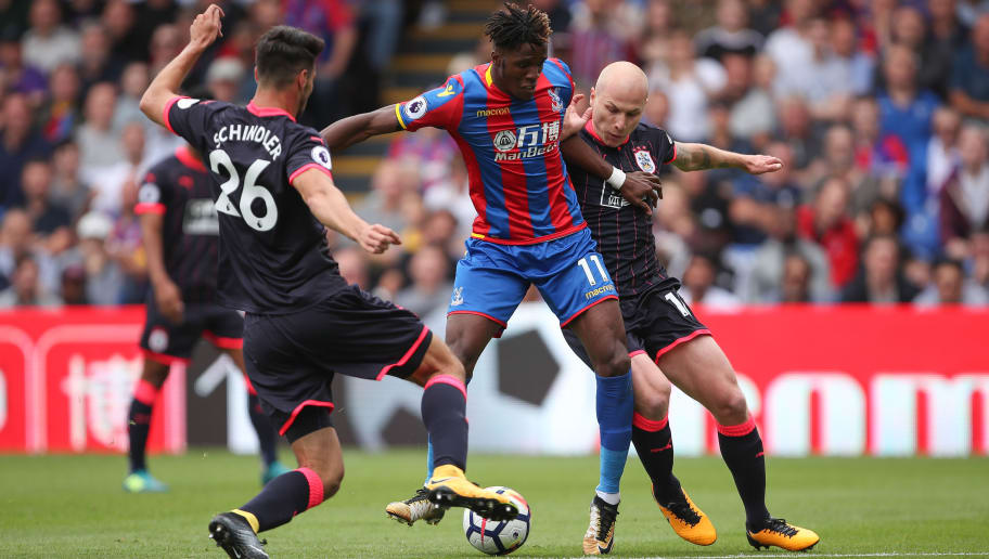 LONDON, ENGLAND - AUGUST 12: Wilfried Zaha of Crystal Palace and Aaron Mooy of Huddersfield Townduring the Premier League match between Crystal Palace and Huddersfield Town at Selhurst Park on August 12, 2017 in London, England. (Photo by Robbie Jay Barratt - AMA/Getty Images)