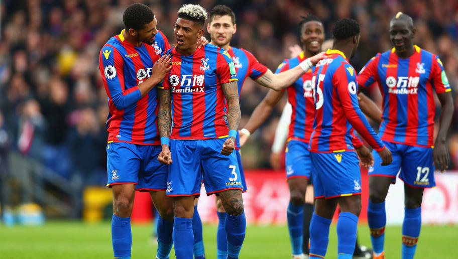 LONDON, ENGLAND - APRIL 28:  Patrick van Aanholt of Crystal Palace celebrates after scoring his sides fourth goal during the Premier League match between Crystal Palace and Leicester City at Selhurst Park on April 28, 2018 in London, England.  (Photo by Clive Rose/Getty Images)