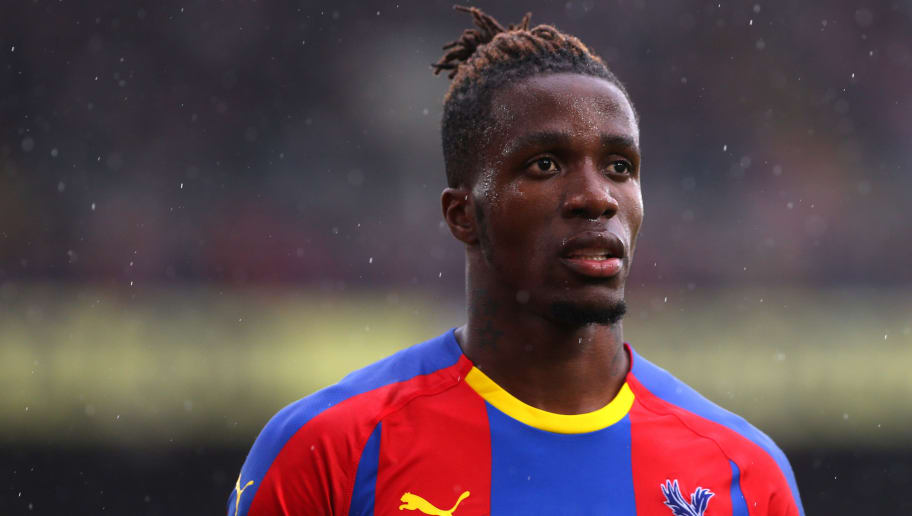 LONDON, ENGLAND - SEPTEMBER 22: Wilfred Zaha of Crystal Palace in action during the Premier League match between Crystal Palace and Newcastle United at Selhurst Park on September 22, 2018 in London, England, United Kingdom. (Photo by Chloe Knott - Danehouse/Getty Images)