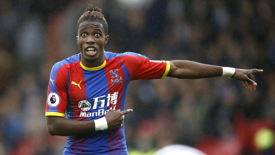 LONDON, ENGLAND - SEPTEMBER 22:  Wilfried Zaha of Crystal Palace gives his team instructions during the Premier League match between Crystal Palace and Newcastle United at Selhurst Park on September 22, 2018 in London, United Kingdom.  (Photo by Julian Finney/Getty Images)