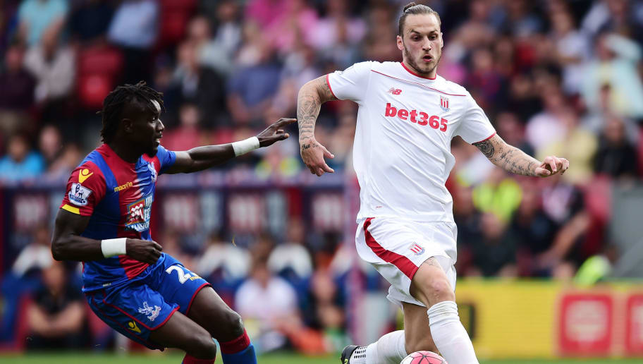 LONDON, ENGLAND - MAY 07:  Papa Souare of Crystal Palace and Marko Arnautovic of Stoke City contest the ball during the Barclays Premier League match between Crystal Palace and Stoke City at Selhurst Park on May 7, 2016 in London, England. (Photo by Alex Broadway/Getty Images)