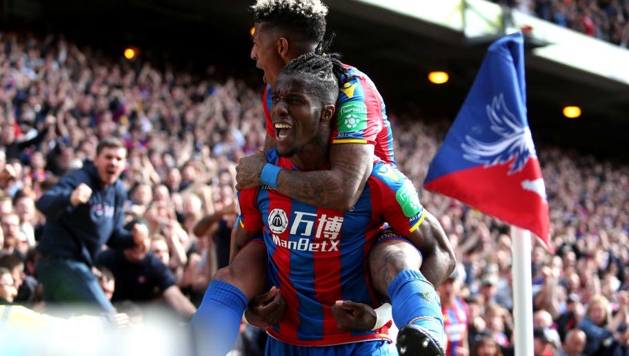 LONDON, ENGLAND - MAY 13:  Wilfried Zaha of Crystal Palace celebrates with Patrick van Aanholt of Crystal Palace after scoring his sides second goal during the Premier League match between Crystal Palace and West Bromwich Albion at Selhurst Park on May 13, 2018 in London, England.  (Photo by Christopher Lee/Getty Images)