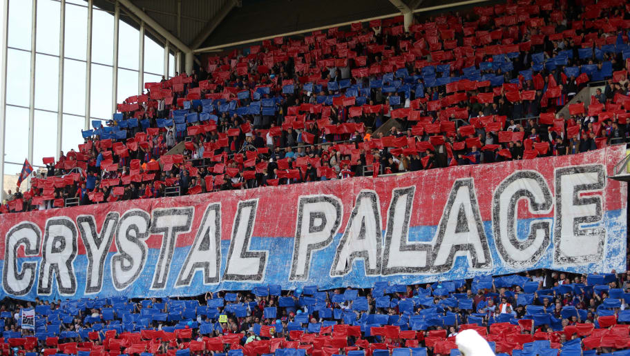 LONDON, ENGLAND - MAY 13:  Crystal Palace fans hold up colours signs during the Premier League match between Crystal Palace and West Bromwich Albion at Selhurst Park on May 13, 2018 in London, England.  (Photo by Christopher Lee/Getty Images)