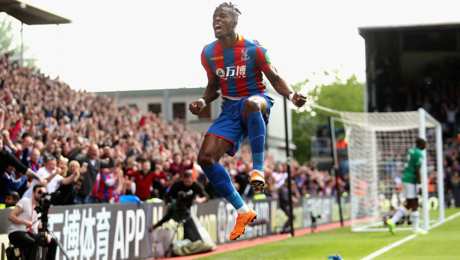 LONDON, ENGLAND - MAY 13:  Wilfried Zaha of Crystal Palace celebrates scoring their first goal during the Premier League match between Crystal Palace and West Bromwich Albion at Selhurst Park on May 13, 2018 in London, England.  (Photo by Christopher Lee/Getty Images)