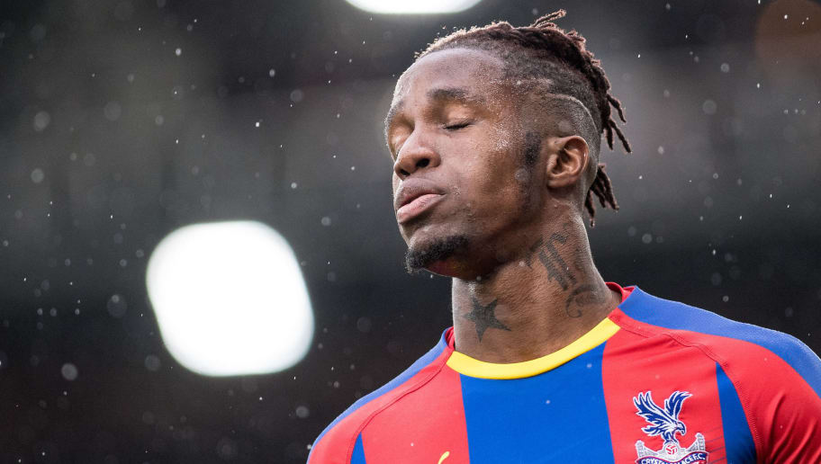 LONDON, ENGLAND - OCTOBER 06: Wilfried Zaha of Crystal Palace looks disappointed  during the Premier League match between Crystal Palace and Wolverhampton Wanderers at Selhurst Park on October 6, 2018 in London, United Kingdom. (Photo by Sebastian Frej/MB Media/Getty Images)