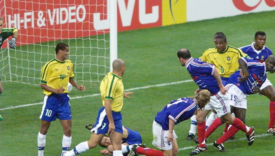 French Zinedine Zidane looks on after scoring a goal for his team 12 July at the Stade de France in Saint-Denis, near Paris,  during the 1998 Soccer World Cup final match between Brazil and France. (ELECTRONIC IMAGE) AFP PHOTO JACQUES DEMARTHON        (Photo credit should read JACQUES DEMARTHON/AFP/Getty Images)