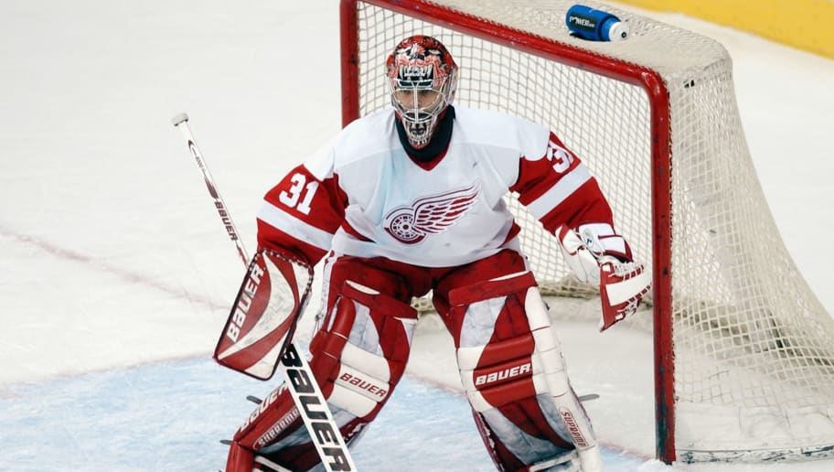 Curtis Joseph looks to make a save