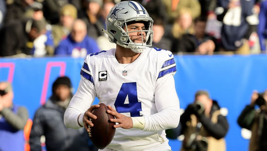EAST RUTHERFORD, NEW JERSEY - DECEMBER 30:  Dak Prescott #4 of the Dallas Cowboys looks to pass against the New York Giants at MetLife Stadium on December 30, 2018 in East Rutherford, New Jersey. (Photo by Steven Ryan/Getty Images)