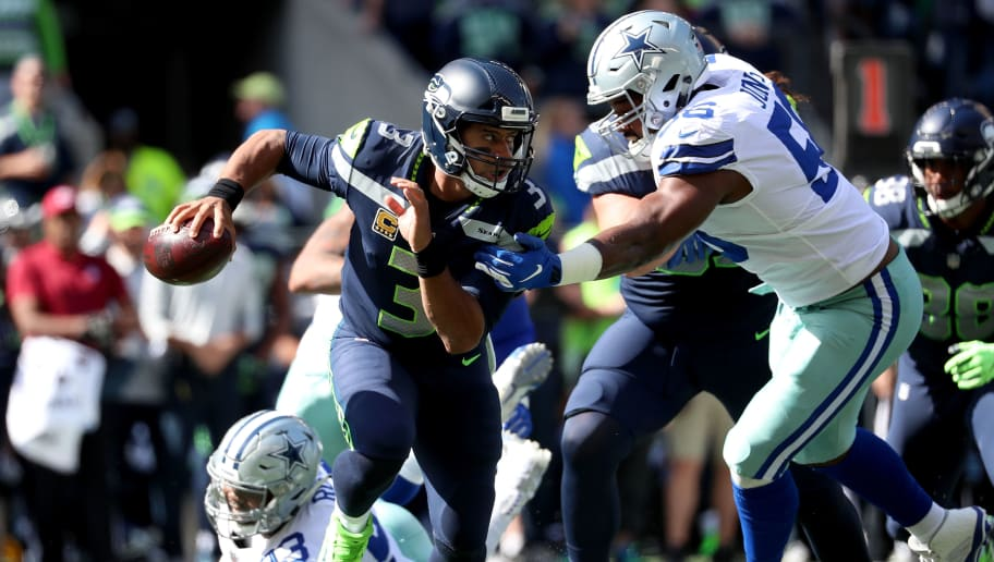 SEATTLE, WA - SEPTEMBER 23:  Russell Wilson #3 of the Seattle Seahawks scrambles in the first quarter against the Dallas Cowboys during their game at CenturyLink Field on September 23, 2018 in Seattle, Washington.  (Photo by Abbie Parr/Getty Images)