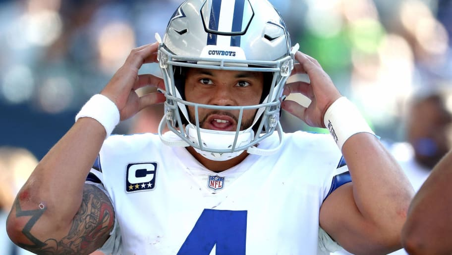 SEATTLE, WA - SEPTEMBER 23:  Dak Prescott #4 of the Dallas Cowboys reacts from the sideline in the fourth quarter against the Seattle Seahawks during their game at CenturyLink Field on September 23, 2018 in Seattle, Washington.  (Photo by Abbie Parr/Getty Images)