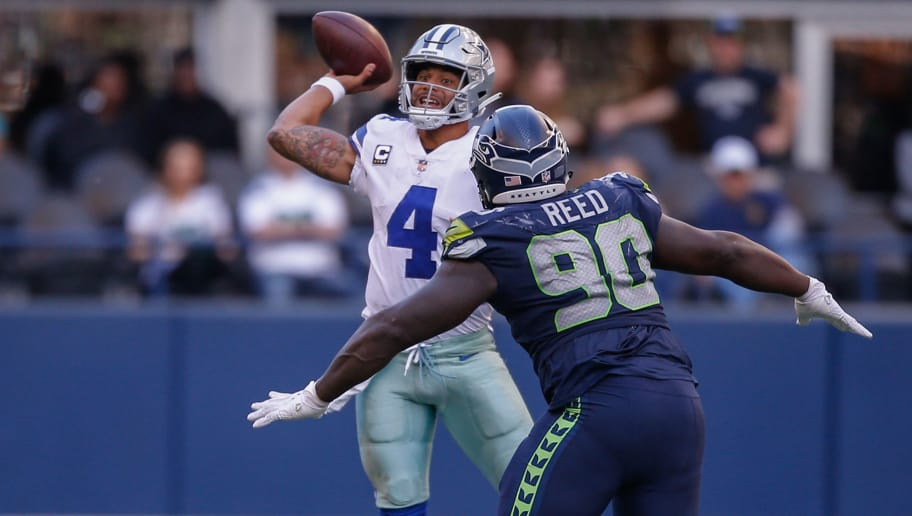 SEATTLE, WA - SEPTEMBER 23:  Quarterback Dak Prescott #4 of the Dallas Cowboys passes against defensive tackle Jarran Reed #90 of the Seattle Seahawks at CenturyLink Field on September 23, 2018 in Seattle, Washington.  (Photo by Otto Greule Jr/Getty Images)