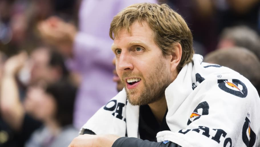 CLEVELAND, OH - APRIL 1: Dirk Nowitzki #41 of the Dallas Mavericks watches from the bench during the second half against the Cleveland Cavaliers at Quicken Loans Arena on April 1, 2018 in Cleveland, Ohio. The Cavaliers defeated the Mavericks 98-87. NOTE TO USER: User expressly acknowledges and agrees that, by downloading and or using this photograph, User is consenting to the terms and conditions of the Getty Images License Agreement. (Photo by Jason Miller/Getty Images) *** Local Caption *** Dirk Nowitzki