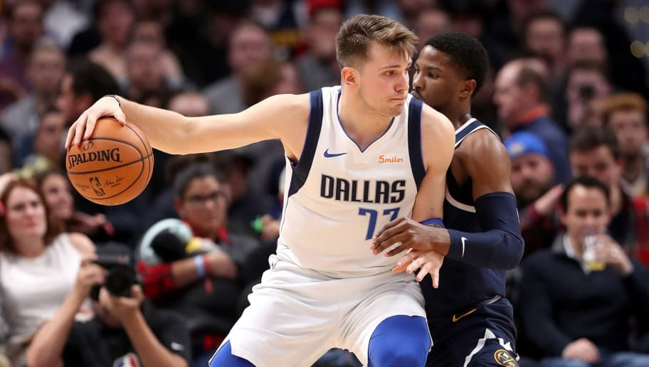 DENVER, COLORADO - DECEMBER 18: Luka Doncic #77 of the Dallas Mavericks is guarded by Torrey Craig #3 of the Denver Nuggets at the Pepsi Center on December 18, 2018 in Denver, Colorado. NOTE TO USER: User expressly acknowledges and agrees that, by downloading and or using this photograph, User is consenting to the terms and conditions of the Getty Images License Agreement. (Photo by Matthew Stockman/Getty Images)