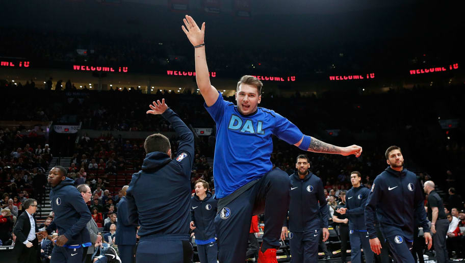 PORTLAND, OR - DECEMBER 23:  Luka Doncic #77 of the Dallas Mavericks during pregame introductions against the Portland Trail Blazers at Moda Center on December 23, 2018 in Portland, Oregon.NOTE TO USER: User expressly acknowledges and agrees that, by downloading and or using this photograph, User is consenting to the terms and conditions of the Getty Images License Agreement.  (Photo by Jonathan Ferrey/Getty Images)