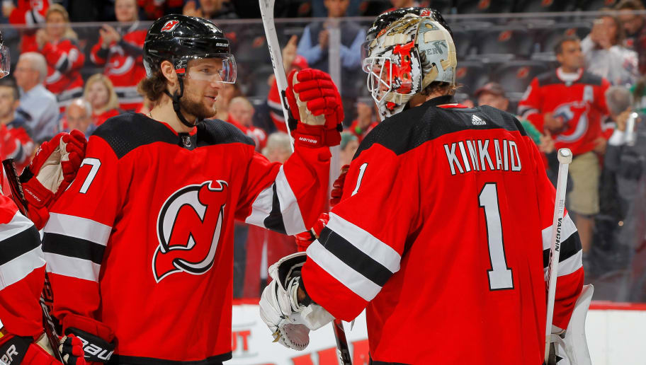 NEWARK, NJ - OCTOBER 16:  Keith Kinkaid #1 and Pavel Zacha #37 of the New Jersey Devils celebrate after defeating the Dallas Stars the at Prudential Center on October 16, 2018 in Newark, New Jersey. The Devils defeated the Stars 3-0.  (Photo by Jim McIsaac/Getty Images)