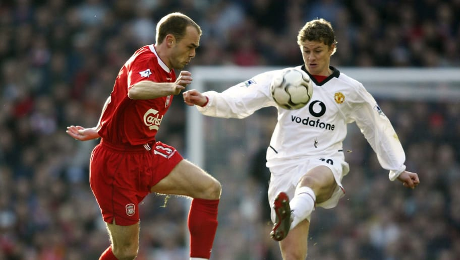LIVERPOOL - DECEMBER 1:  Danny Murphy of Liverpool loses out to Ole Gunnar Solskjaer of Manchester United during the FA Barclaycard Premiership match held on December 1, 2002 at Anfield, in Liverpool, England. Manchester United won the match 2-1. (Photo by Gary M. Prior/Getty Images)