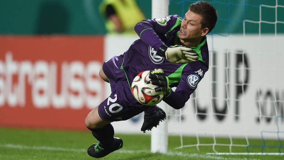 DARMSTADT, GERMANY - AUGUST 17:  Goalkeeper Max Gruen of Wolfsburg saves the decisive penalty  of Milan Ivana of Darmstadt in the shootout during the DFB Cup first round match between SV Darmstadt 98 and VfL Wolfsburg at Stadion am Boellenfalltor on August 17, 2014 in Darmstadt, Germany.  (Photo by Matthias Hangst/Bongarts/Getty Images)