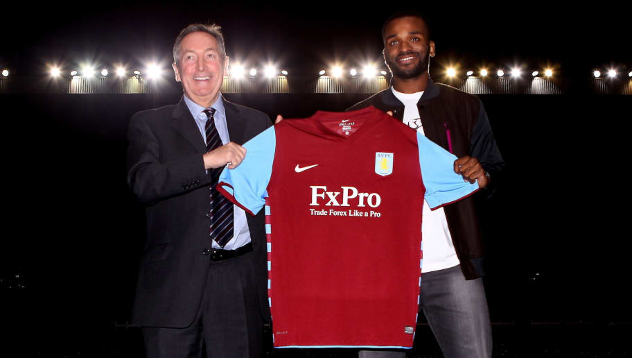 BIRMINGHAM, ENGLAND - JANUARY 18:  Darren Bent (R) and manager Gerrard Houllier hold the shirt during a press conference to announce him signing for Aston Villa at Villa Park on January 18, 2011 in Birmingham, England.  (Photo by Scott Heavey/Getty Images)