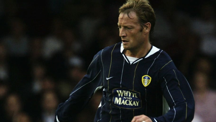 YORK - JULY 23:  David Batty of Leeds United runs with the ball during the Pre-Season Friendly match between York City and Leeds United held on July 23, 2003 at Bootham Crescent, in York, England. The match ended in a 1-1 draw. (Photo by Bryn Lennon/Getty Images)
