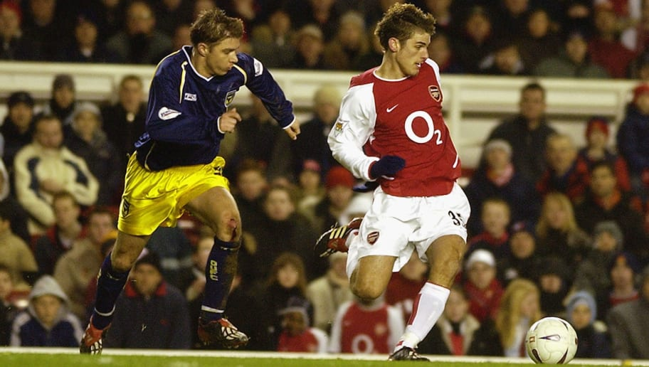 David Bentley of Arsenal skips past Bobby Ford of Oxford United