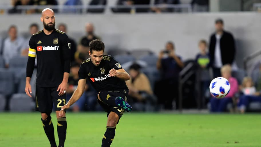 LOS ANGELES, CA - MAY 26:  Laurent Ciman #23 looks on as Diego Rossi #9 of Los Angeles FC takes a free kick during the first half of a game against the D.C. United at Banc of California Stadium on May 26, 2018 in Los Angeles, California.  (Photo by Sean M. Haffey/Getty Images)