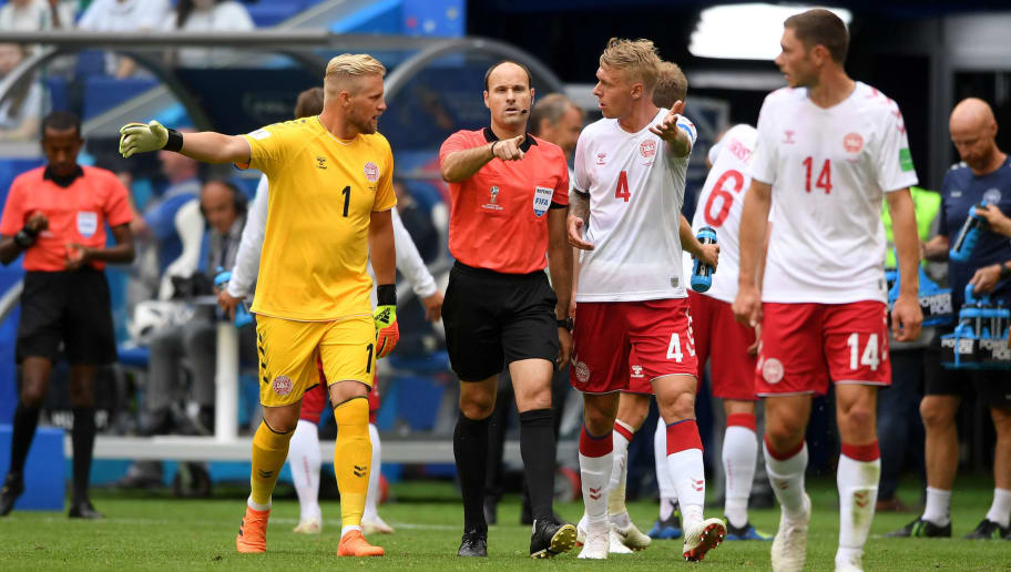SAMARA, RUSSIA - JUNE 21:  Simon Kjaer of Denmark and Kasper Schmeichel of Denmark confront referee Antonio Mateu after he awards Australia a penalty during the 2018 FIFA World Cup Russia group C match between Denmark and Australia at Samara Arena on June 21, 2018 in Samara, Russia.  (Photo by Stu Forster/Getty Images)