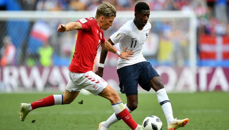MOSCOW, RUSSIA - JUNE 26:  Jens Stryger Larsen of Denmark challenge for the ball with Ousmane Dembele of France during the 2018 FIFA World Cup Russia group C match between Denmark and France at Luzhniki Stadium on June 26, 2018 in Moscow, Russia.  (Photo by Dan Mullan/Getty Images)