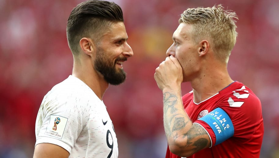 MOSCOW, RUSSIA - JUNE 26:  Olivier Giroud of France talks to Simon Kjaer of Denmark during the 2018 FIFA World Cup Russia group C match between Denmark and France at Luzhniki Stadium on June 26, 2018 in Moscow, Russia.  (Photo by Ryan Pierse/Getty Images)