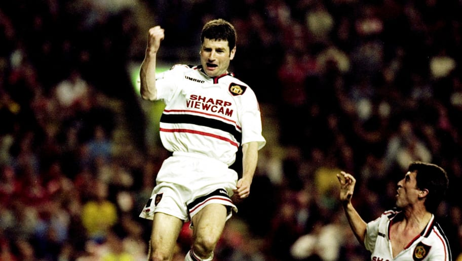 Dennis Irwin and Roy Keane of Manchester United