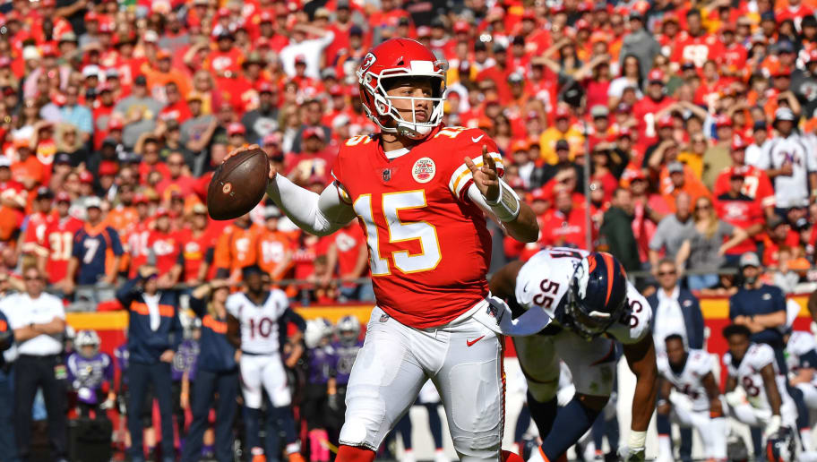 KANSAS CITY, MO - OCTOBER 28:  Quarterback Patrick Mahomes #15 of the Kansas City Chiefs looks down field to throw a pass during the first half against the Denver Broncos on October 28, 2018 at Arrowhead Stadium in Kansas City, Missouri.  (Photo by Peter G. Aiken/Getty Images)
