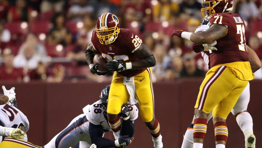 LANDOVER, MD - AUGUST 24: Running back Adrian Peterson #26 of the Washington Redskins rushes past linebacker Von Miller #58 of the Denver Broncos in the first quarter during a preseason game at FedExField on August 24, 2018 in Landover, Maryland. (Photo by Patrick Smith/Getty Images)