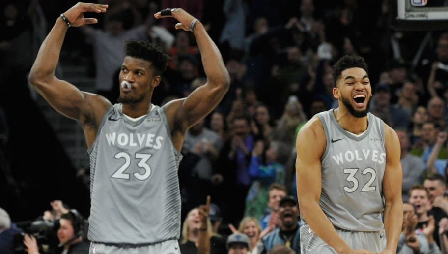 MINNEAPOLIS, MN - APRIL 11: Jimmy Butler #23 and Karl-Anthony Towns #32 of the Minnesota Timberwolves celebrate in the final minute of overtime of the game against the Denver Nuggets on April 11, 2018 at the Target Center in Minneapolis, Minnesota. The Timberwolves defeated the Nuggets 112-106. NOTE TO USER: User expressly acknowledges and agrees that, by downloading and or using this Photograph, user is consenting to the terms and conditions of the Getty Images License Agreement. (Photo by Hannah Foslien/Getty Images)