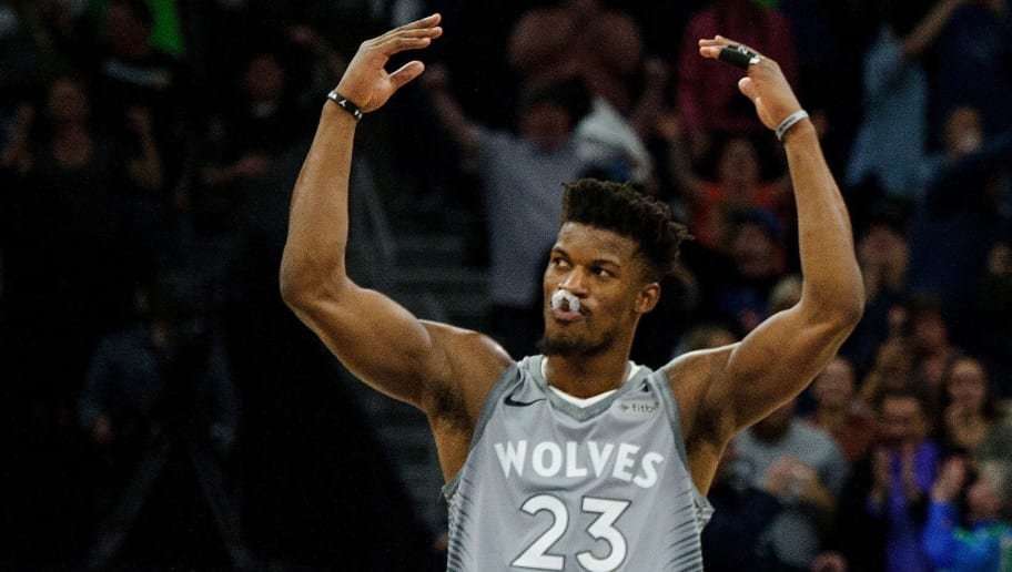 MINNEAPOLIS, MN - APRIL 11: Jimmy Butler #23 and Karl-Anthony Towns #32 of the Minnesota Timberwolves celebrate during the game against the Denver Nuggets on April 11, 2018 at the Target Center in Minneapolis, Minnesota. The Timberwolves defeated the Nuggets 112-106. NOTE TO USER: User expressly acknowledges and agrees that, by downloading and or using this Photograph, user is consenting to the terms and conditions of the Getty Images License Agreement. (Photo by Hannah Foslien/Getty Images)
