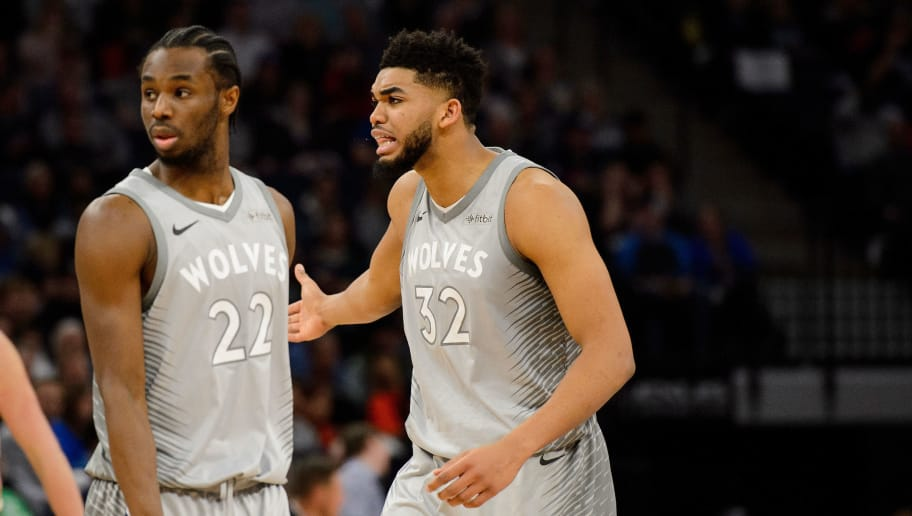 MINNEAPOLIS, MN - APRIL 11: Andrew Wiggins #22 and Karl-Anthony Towns #32 of the Minnesota Timberwolves look on during the game against the Denver Nuggets on April 11, 2018 at the Target Center in Minneapolis, Minnesota. The Timberwolves defeated the Nuggets 112-106. NOTE TO USER: User expressly acknowledges and agrees that, by downloading and or using this Photograph, user is consenting to the terms and conditions of the Getty Images License Agreement. (Photo by Hannah Foslien/Getty Images)