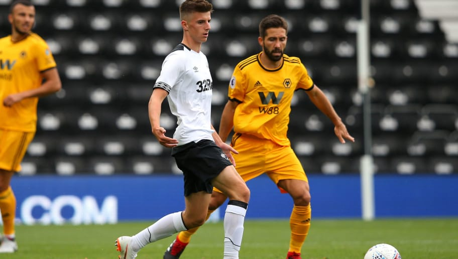 DERBY, ENGLAND - JULY 28:  Mason Mount of Derby County controls the ball ahead of Joao Moutinho of Wolverhampton Wanderers during a pre-season friendly match between Derby County and Wolverhampton Wanderers at Pride Park on July 28, 2018 in Derby, England.  (Photo by Alex Livesey/Getty Images)