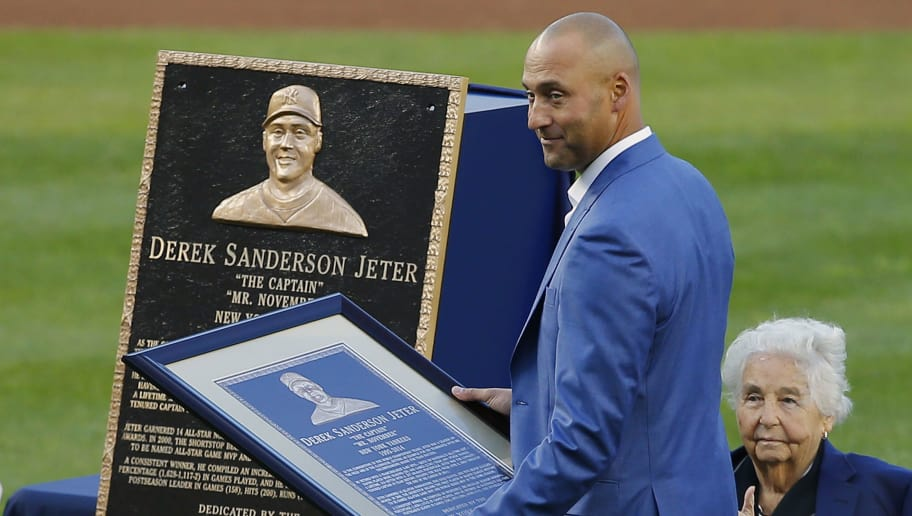 NEW YORK, NY - MAY 14: Former New York Yankees great, Derek Jeter stands in front of his plaque during a pregame ceremony honoring Jeter and retiring his number 2 at Yankee Stadium on May 14, 2017 in New York City. (Photo by Rich Schultz/Getty Images)