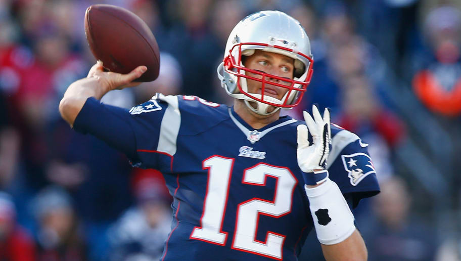 FOXBORO, MA - NOVEMBER 23:  Tom Brady #12 of the New England Patriots passes the ball during the first quarter against the Detroit Lions at Gillette Stadium on November 23, 2014 in Foxboro, Massachusetts.  (Photo by Jared Wickerham/Getty Images)