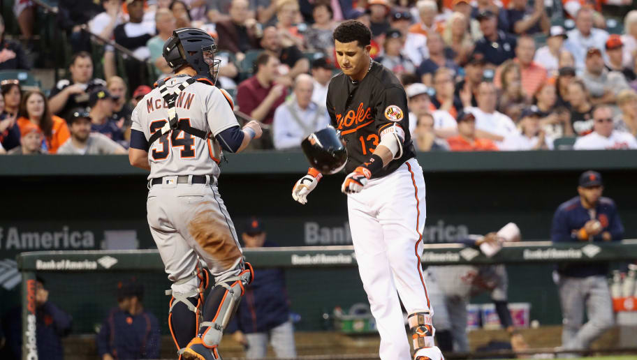 BALTIMORE, MD - MAY 13: Manny Machado #13 of the Baltimore Orioles throws his helmet after striking out swinging to end the third inning as catcher James McCann #34 of the Detroit Tigers walk away at Oriole Park at Camden Yards on May 13, 2016 in Baltimore, Maryland.  (Photo by Rob Carr/Getty Images)