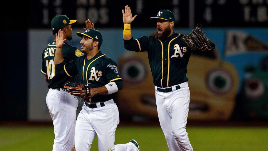 OAKLAND, CA - AUGUST 04:  Nick Martini #38 of the Oakland Athletics, Marcus Semien #10 and Ramon Laureano #22 celebrate after the game against the Detroit Tigers at the Oakland Coliseum on August 4, 2018 in Oakland, California. The Oakland Athletics defeated the Detroit Tigers 2-1. (Photo by Jason O. Watson/Getty Images)