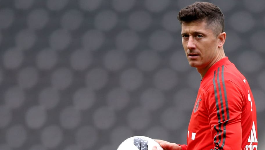 BERLIN, GERMANY - MAY 18:  Robert Lewandowski of Bayern Muenchen warms up during a training session one day ahead of the DFB Cup Final 2018 between Bayern Muenchen and Eintracht Frankfurt at Olympiastadion on May 18, 2018 in Berlin, Germany.  (Photo by Lars Baron/Bongarts/Getty Images)
