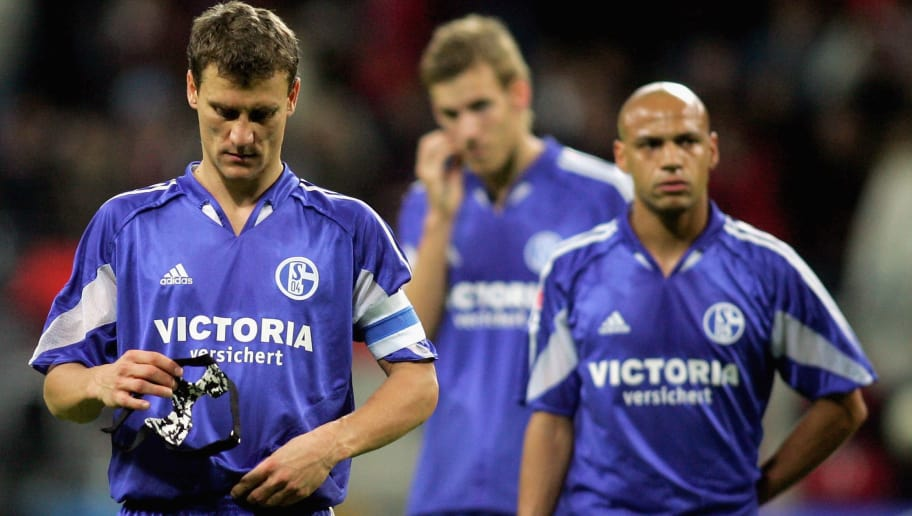 FRANKFURT, GERMANY - OCTOBER 25: Ebbe Sand, Soeren Larsen and Gustavo Varela look dejected after loosing the DFB German Cup second round match between Eintracht Frankfurt and Schalke 04 at the Commerzbank Arena on October 25, 2005 in Frankfurt, Germany.  (Photo by Lars Baron/Bongarts/Getty Images)