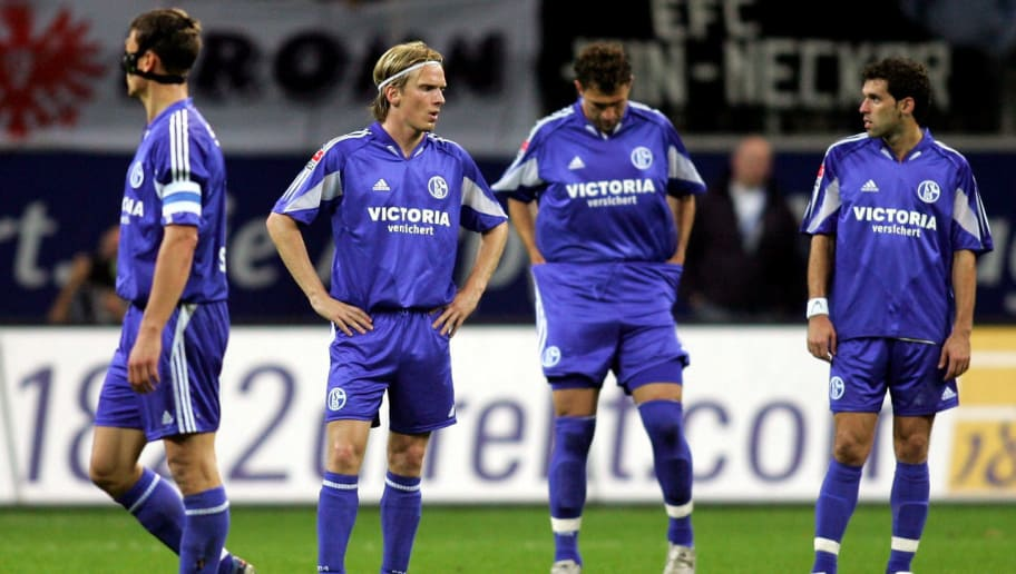 FRANKFURT, GERMANY - OCTOBER 25: Ebbe Sand, Christian Poulsen, Marcelo Bordon and Lincoln of Schalke look dejected after losing the DFB German Cup second round match between Eintracht Frankfurt and Schalke 04 at the Commerzbank Arena on October 25, 2005 in Frankfurt, Germany.  (Photo by Lars Baron/Bongarts/Getty Images)