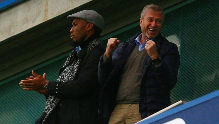 LONDON, ENGLAND - DECEMBER 19:  Didier Drogba (L) of Montreal Impact and Chelsea owner Roman Abramovich (R) celebrate Chelsea's second goal on the stand prior to the Barclays Premier League match between Chelsea and Sunderland at Stamford Bridge on December 19, 2015 in London, England.  (Photo by Clive Mason/Getty Images)